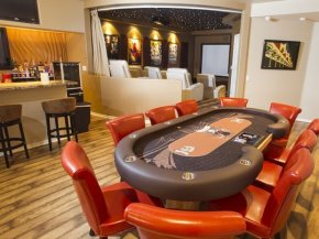 The basement poker table, club and theater location in the